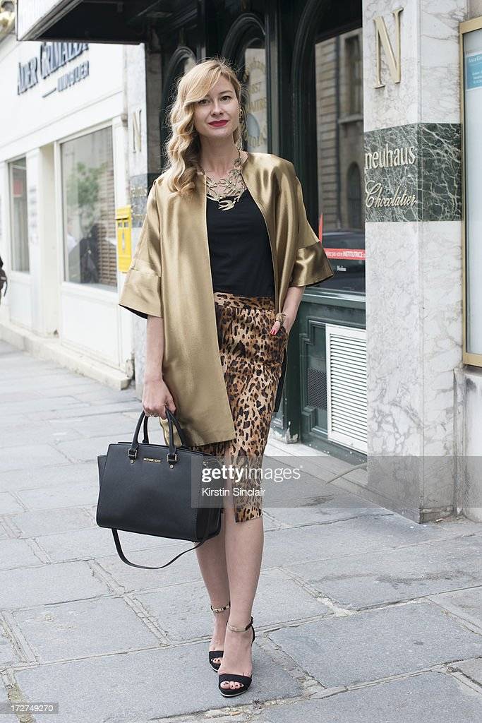 Make up artist Renata Khafizova wears her own design coat, Zara skirt, H and M top, Bershka shoes and a Michael Kors bag on day 3 of Paris Collections: Womens Haute Couture on July 03, 2013 in Paris, France.