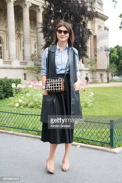 Make Up Artist Vera Baratova wearing an Asos gillet vintage shirt and sunglasses Agnes B skirt and Marc Jacobs shoes day 3 of Paris Haute Couture...