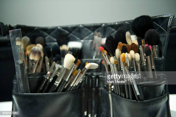 Make up artists are equipped with an arsenal of makeup brushes backstage before the presentation of Mr Start autumn 2011 collection at One Aldwych in...