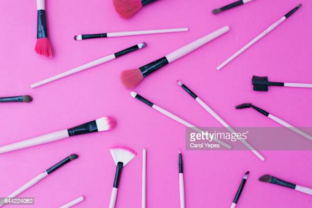 make up brushes in pink background
