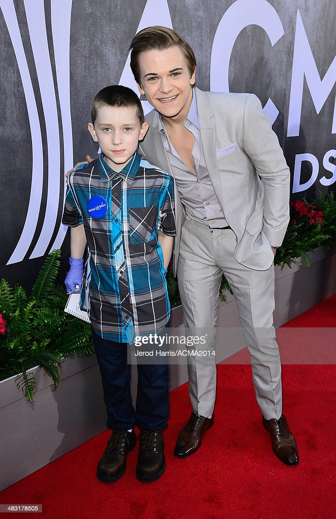 Make-A-Wish Foundation recipient Matthew (L) poses with recording artist <a gi-track='captionPersonalityLinkClicked' href=/galleries/search?phrase=Hunter+Hayes&family=editorial&specificpeople=3290701 ng-click='$event.stopPropagation()'>Hunter Hayes</a> at the 49th Annual Academy of Country Music Awards at the MGM Grand Garden Arena on April 6, 2014 in Las Vegas, Nevada.