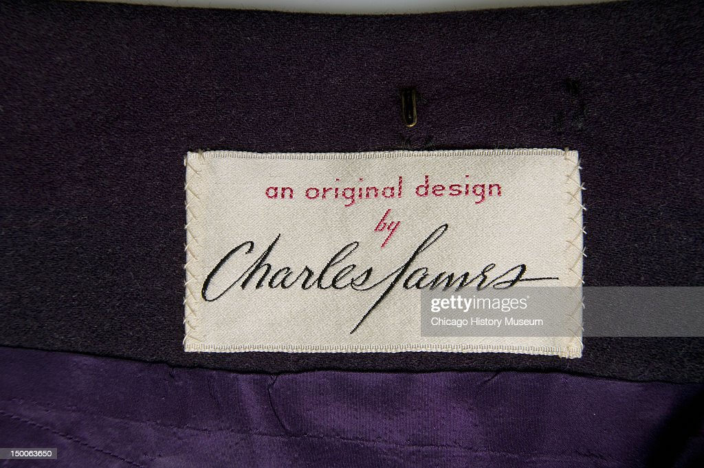Maker label inside Charles James Pagoda tunic suit 1955 Known as the 'Pagoda' James ranked this garment among his top four creations for its emphasis...
