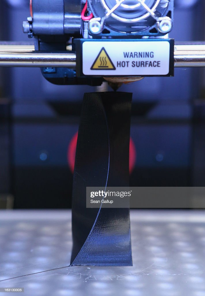 A MakerBot 3D printer creates an object from molten plastic at the 2013 CeBIT technology trade fair on March 5, 2013 in Hanover, Germany. CeBIT will be open March 5-9.