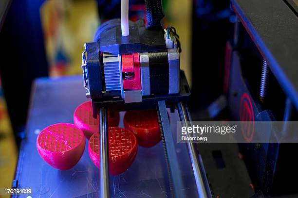 A Makerbot Industries LLC Replicator 2 Desktop 3D Printer constructs a design at the company's new factory in the Brooklyn borough of New York US on...