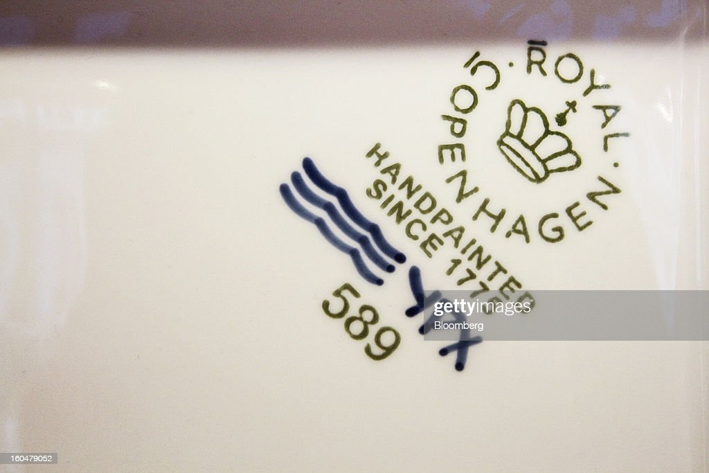 A maker's mark sits on the base of an item of hand-painted Danish porcelain for sale at the Royal Copenhagen store on Storget street in Copenhagen, Denmark, on Friday, Feb. 1, 2013. Danish regional banks are struggling to emerge from a burst property bubble that's forced the government resolution agency to take over a dozen lenders after losses on commercial and agricultural loans wiped out capital. Photographer: Freya Ingrid Morales/Bloomberg via Getty Images