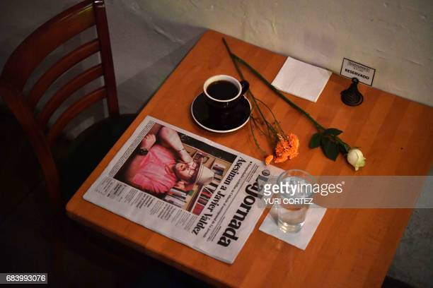 A makeshift altar with a cup of coffee and water glass is pictured in a cafe previously frequented by slain Mexican journalist Javier Valdez in...