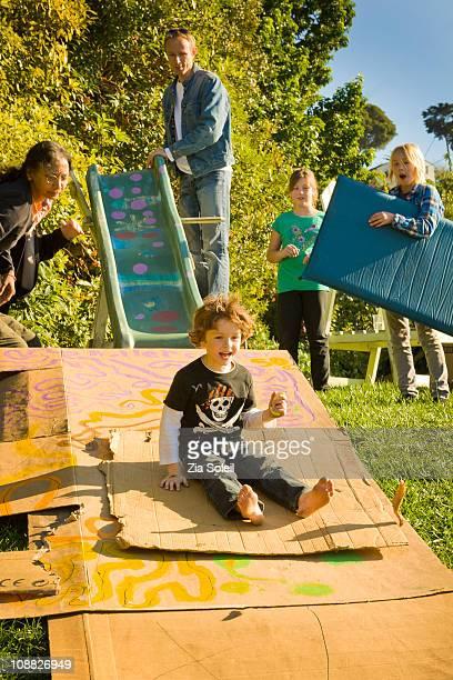 makeshift backyard family sliding and play