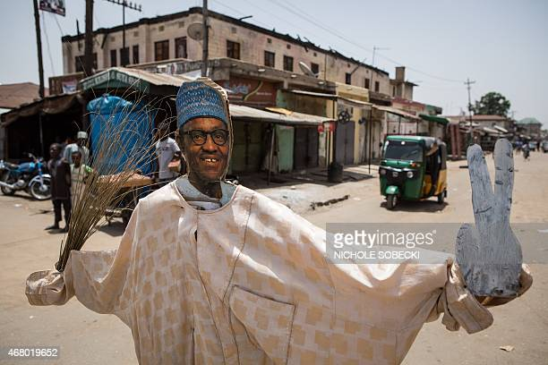 A makeshift figure of former military ruler and presidential candidate Muhammadu Buhari stands in an intersection in Kaduna on March 29 2015 Kaduna...