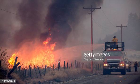 A makeshift fire truck puts water on a wildfire which is part of the Okanogan Complex as it burns through brush on August 22 2015 near Omak...
