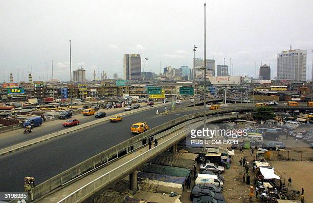 Makeshift homes are erected by the poor under a Lagos flyover overlooking the skyscrapers that dot central Lagos 02 April 2004 Despite having...