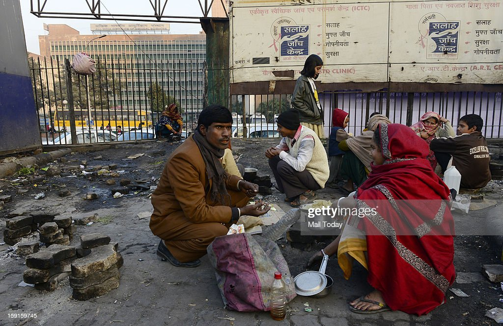 A makeshift kitchen used by attendents of patients at AIIMS at a dirty pavement outside the hospital complex.
