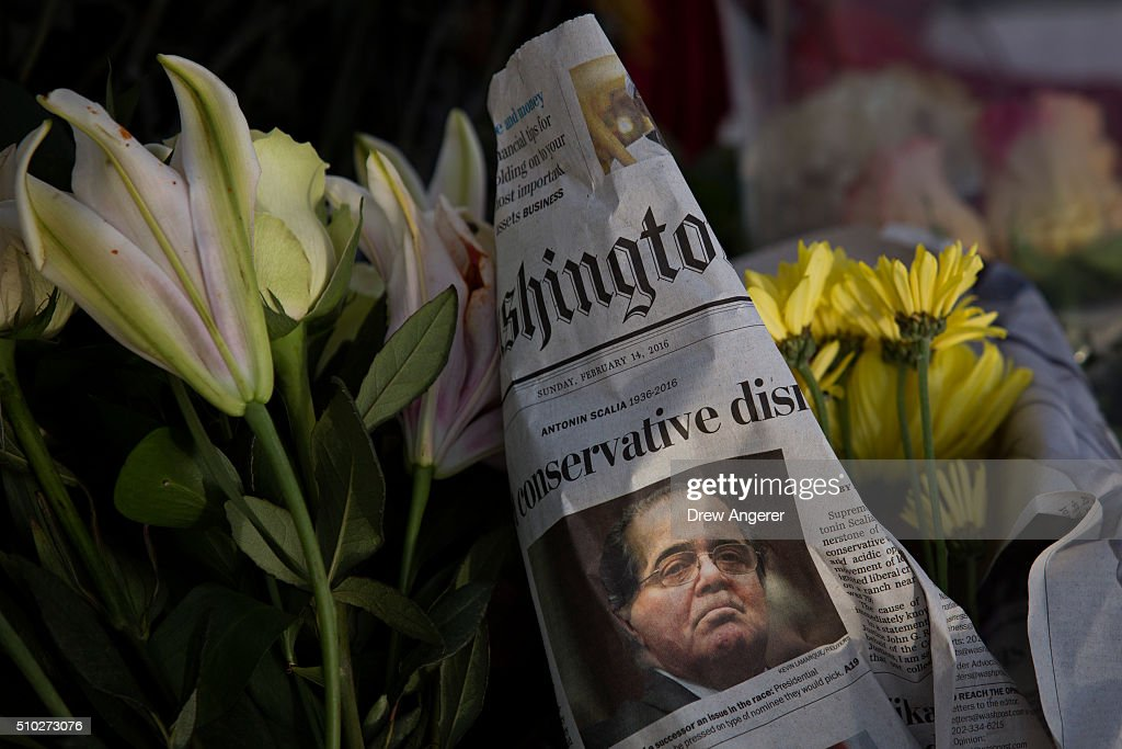 A makeshift memorial for Supreme Court Justice Antonin Scalia is seen at the U.S. Supreme Court, February 14, 2016 in Washington, DC. Supreme Court Justice Antonin Scalia was at a Texas Ranch Saturday morning when he died at the age of 79.