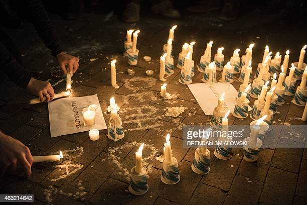 A makeshift memorial is made during a vigil at the University of North Carolina following the murders of three Muslim students on February 11 2015 in...