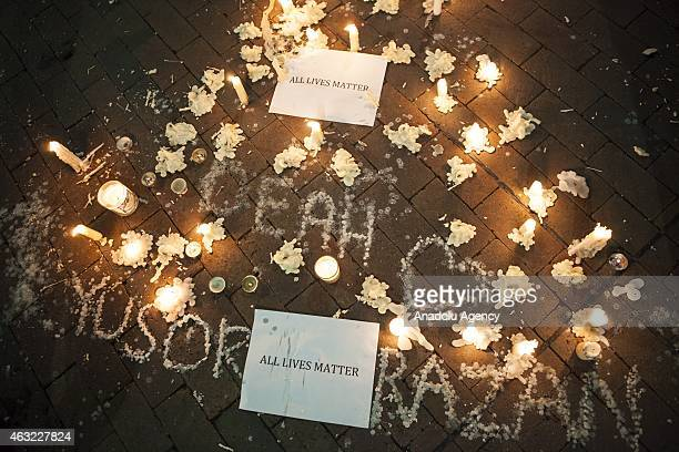 A makeshift memorial is seen during a vigil at the University of North Carolina for Deah Shaddy Barakat his wife Yusor Mohammad and her sister Razan...