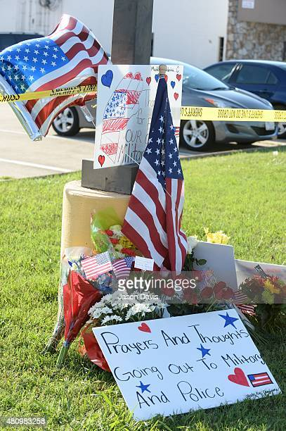 A makeshift memorial is sits outside of the scene of a shooting at a Armed Forces Career Center/National Guard recruitment office on July 16 2015 in...