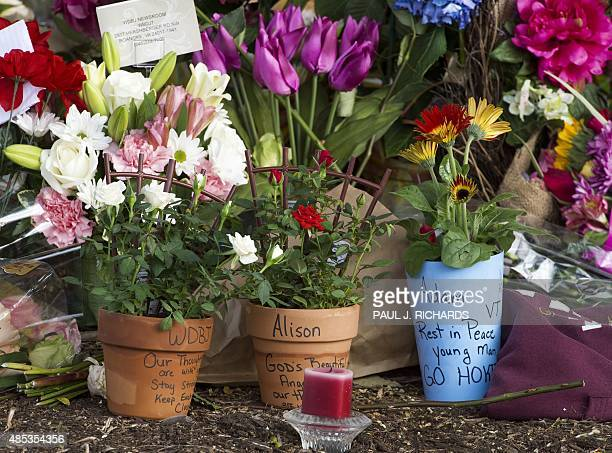 A makeshift memorial is viewed at the gate of WDBJ's television studios August 27 2015 in Roanoke Virginia The former television reporter who shot...