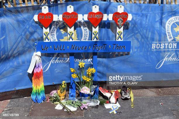 A makeshift memorial set up at the spot where the bomb went off near the finish line on the eve of the 2014 Boston Marathon April 20 2014 in Boston...