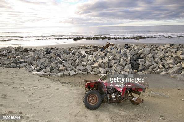 Makeshift sea defences and old quad bike on the island of Shishmaref Alaska Global Warming has caused the sea ice to retreat leaving the Inuit...