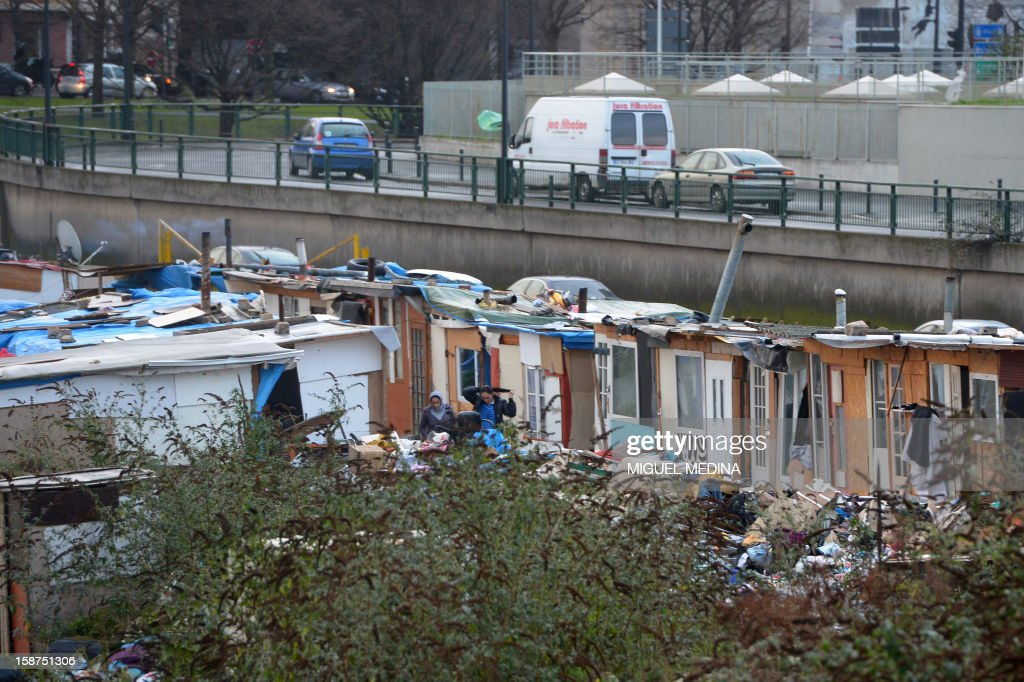 Makeshift shelters are pictured in a slum area near the Stade de France in Saint-Denis, northern Paris, on December 27, 2012. AFP PHOTO MIGUEL MEDINA
