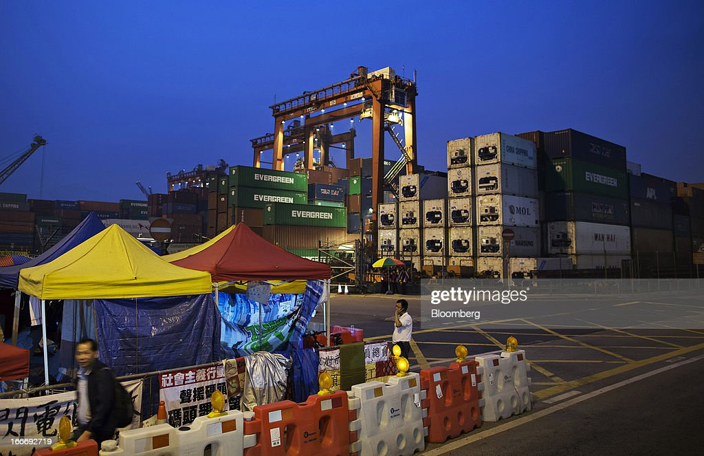 Makeshift shelters set up by dockworkers stand outside Kwai Tsing Container Terminal 6 operated by Hong Kong International Terminals Ltd. in Hong Kong, China, on Monday, April 15, 2013. The Hong Kong government will hold mediation meetings to resolve the dockers strike on April 16 and hopes to find a solution this week, Matthew Cheung, secretary for labour and welfare, told reporters on April 15. Photographer: Jerome Favre/Bloomberg via Getty Images