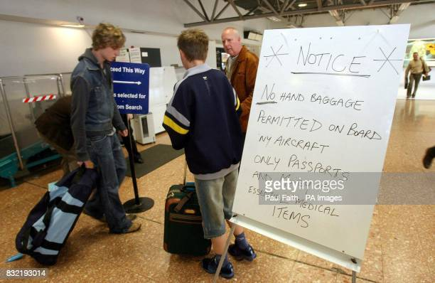 A makeshift sign greets travellers at Belfast International Airport today after a 'very significant' terrorist plot to blow up aircraft in midair was...