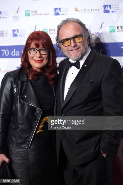 Makeup artist Alessandro Bertolazzi and wife attend a photocall for Nastri D'Argento on March 22 2017 in Rome Italy
