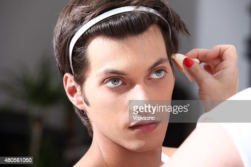 makeup artist applying foundation with a brush : Stock Photo