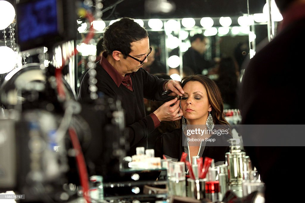 Makeup artist Bruce Grayson applies singer/songwriter <a gi-track='captionPersonalityLinkClicked' href=/galleries/search?phrase=Sara+Evans&family=editorial&specificpeople=215184 ng-click='$event.stopPropagation()'>Sara Evans</a>' makeup at Behind The Beauty Documentary - Day 2 at The Redbury Hotel on December 19, 2012 in Hollywood, California.