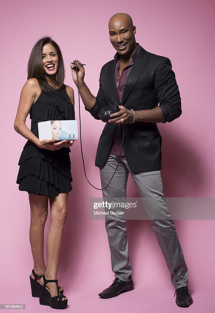 Makeup artist Elena Adorno and Marc Harvey of 'Element 2 Beauty' at the Mark Kearney Group 'Iced Out' Luxury Emmy Suite on September 19, 2013 in Los Angeles, California.