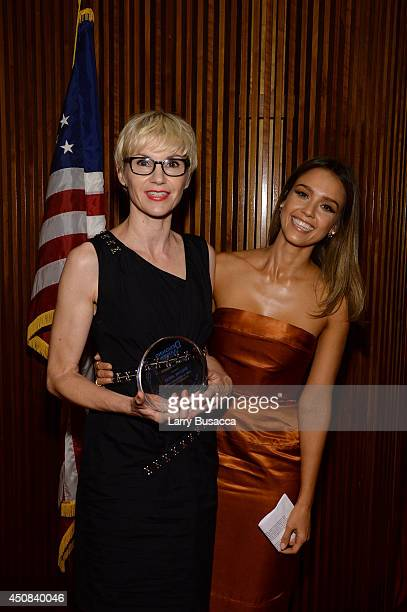 Makeup artist Evelyne Noraz and actress Jessica Alba attend the 2014 New York Women In Film And Television 'Designing Women' Awards Gala at McGraw...