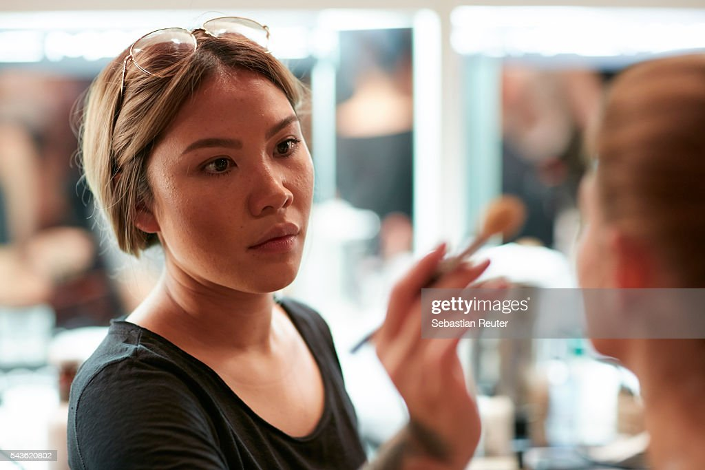 A makeup artist is seen in the backstage at the 0039 Italy show during the Mercedes-Benz Fashion Week Berlin Spring/Summer 2017 at Borchardt on June 29, 2016 in Berlin, Germany.