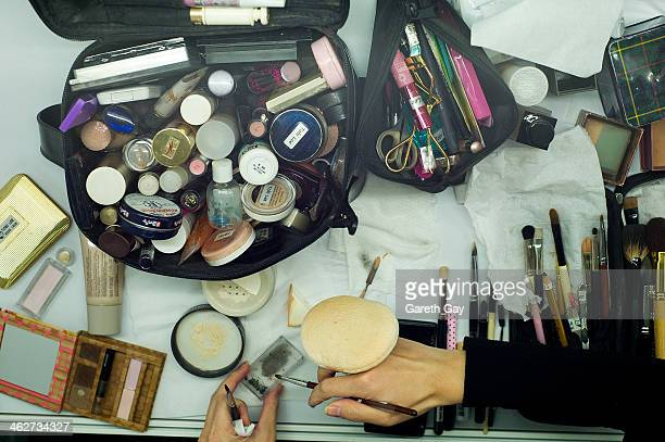 A makeup artist lays out the tools of her trade backstage ahead of the Angela Chung and Gregorius Vici show during Hong Kong Fall/Winter Fashion Week...