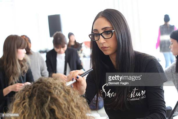 Makeup artist Lea Esposito prepares models at SheaMoisture at Laquan Smith F/W 2016 NYFW at Jack Studios on February 14 2016 in New York City