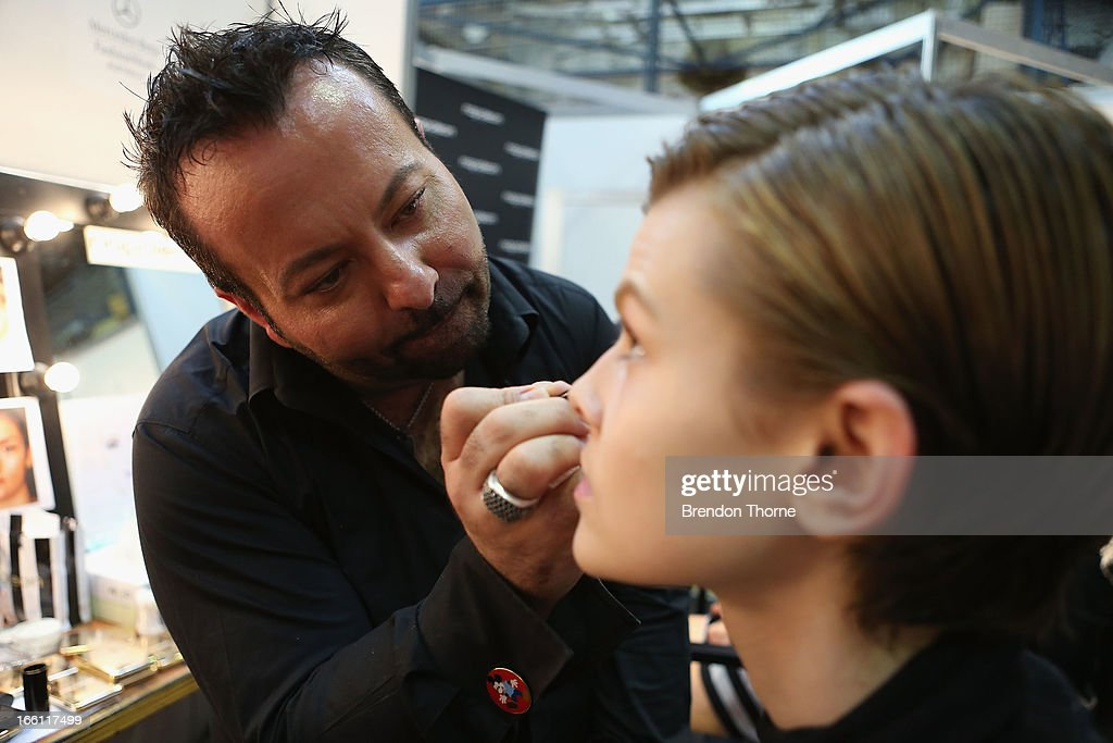 Makeup artist Napoleon Perdis prepares a model backstage ahead of the Maticevski show during Mercedes-Benz Fashion Week Australia Spring/Summer 2013/14 at Carriageworks on April 9, 2013 in Sydney, Australia.
