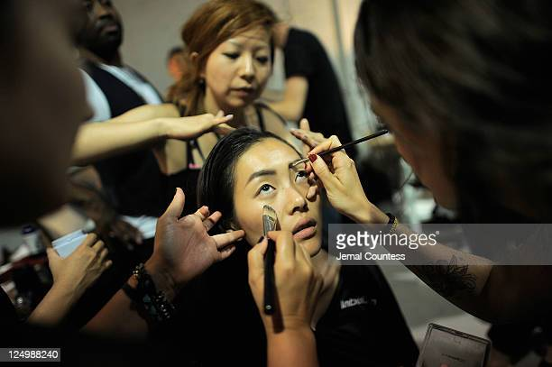 Makeup artist prepare a model backstage at the Proenza Schouler Spring 2012 fashion show during MercedesBenz Fashion Week at 330 West St on September...