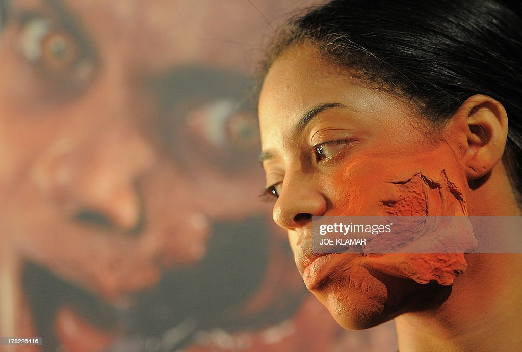 A make-up artist uses air brush as works on a model during Universal Studios' 'Halloween Horror Nights' media make-up kick-off at The Globe Theatre on August 27, 2013 in Universal City, California.