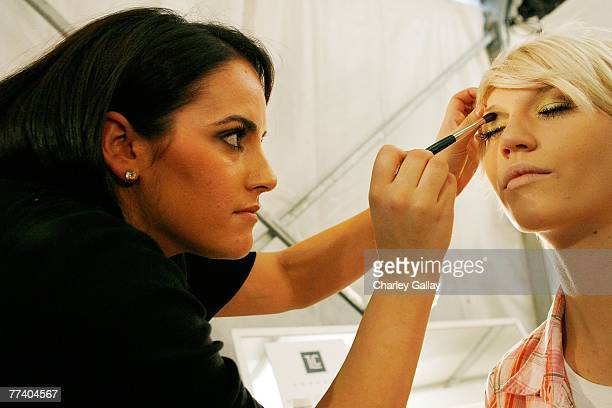 A makeup artist works on a model backstage at the Monarchy Collection Spring 2008 fashion show during MercedesBenz Fashion Week held at Smashbox...
