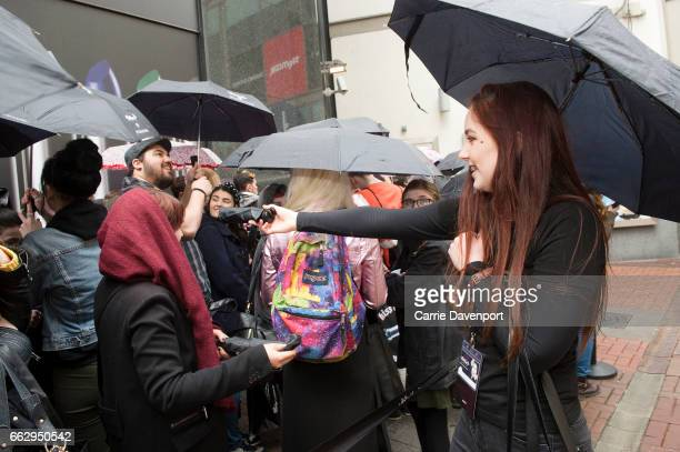 Makeup artists give out free cosmetics to fans waiting to meet Kat Von D at Debenhams Henry Street>> on April 1 2017 in Dublin Ireland