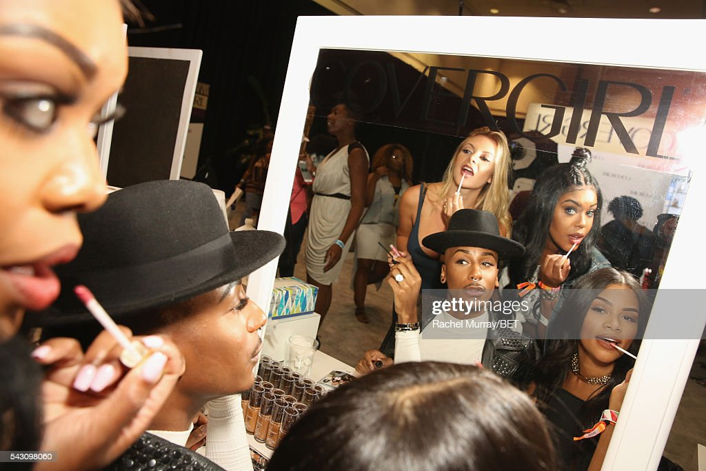 Makeup artists work the Covergirl station at Fashion And Beauty @BETX presented by Progressive, Covergirl, Strength of Nature, Korbel and Macy's during the 2016 BET Experience on June 25, 2016 in Los Angeles, California.