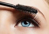 Close-up of make-up blue eye with long lashes with black mascara