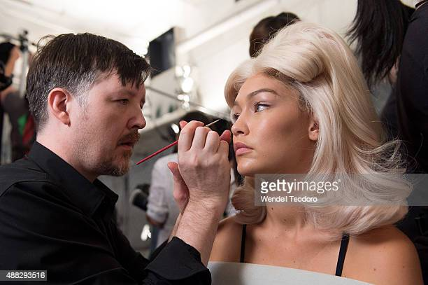 Makeup Director Kabuki and model Gigi Hadid prepare backstage before the Jeremy Scott show at The Arc Skylight at Moynihan Station as part of 'NYFW...
