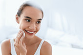 Makeup Remove. Beautiful Girl Cleaning Face Skin With White Cosmetic Pad. High Resolution