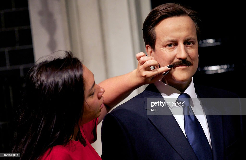 A make-up technician adjusts the moustache on the wax figure of British Prime Minister David Cameron displayed at Madame Tussauds Museum in London on November 7, 2012 in support of Movember. During November each year, men in the UK and other parts of the world grow moustaches to raise awareness and funds for men's health, specifically prostate cancer and testicular cancer.