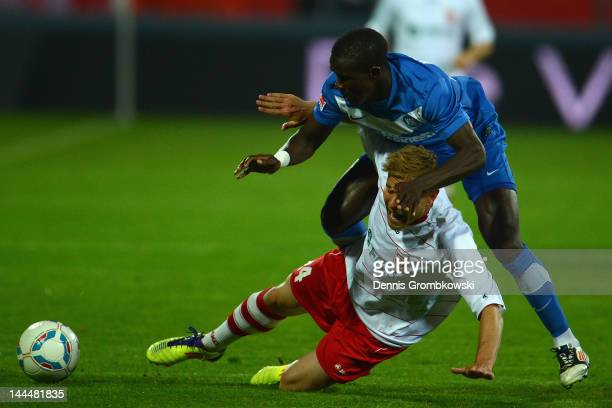 Makhtar Thioune of Karlsruhe and Tim Erfen of Regensburg battle for the ball during the Second Bundesliga relegation match between Karlsruher SC and...