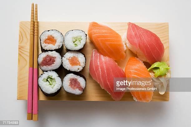 Maki sushi and nigiri sushi on sushi board