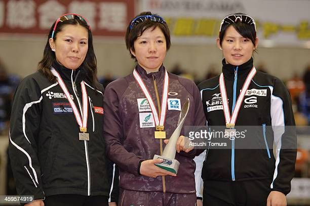 Maki Tsuji of Japan poses with the silver medal Nao Kodaira of Japan poses with the gold medal and Erina Kamiya of Japan poses with the bronze medal...