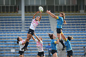 Makiko Tomita of Japan and Teryayeva Olessya of Kazakhstan compete for the lineout ball during the World Sevens Asia Olympic Qualification match...