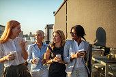 Happy businesswomen having a coffee break together.