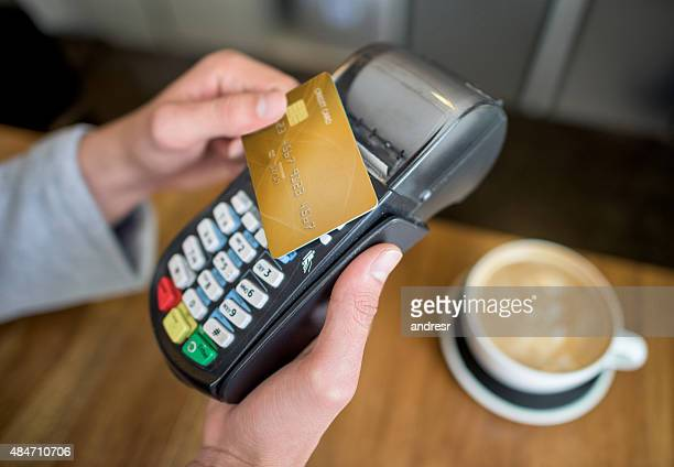 Making a contactless payment at coffee shop