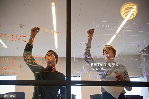 making a diagram on conference room window